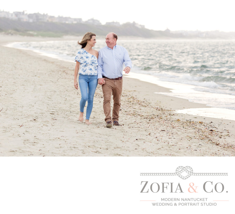 jetties beach engaged couple walking