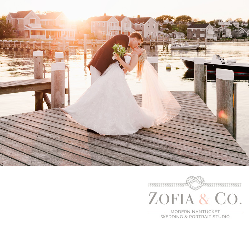 groom dips bride great harbor yacht club dock