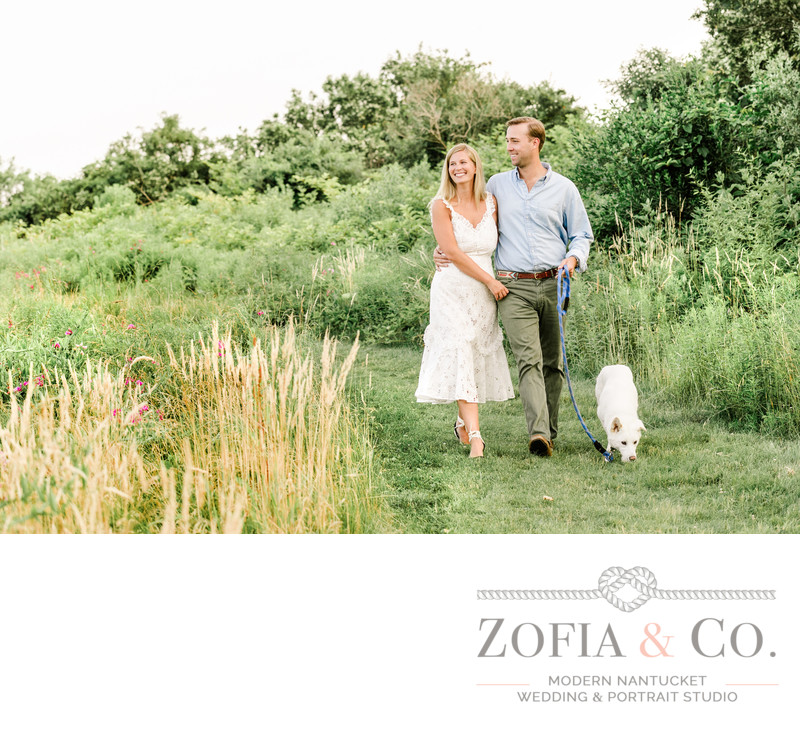 engaged couple walking dog in nantucket