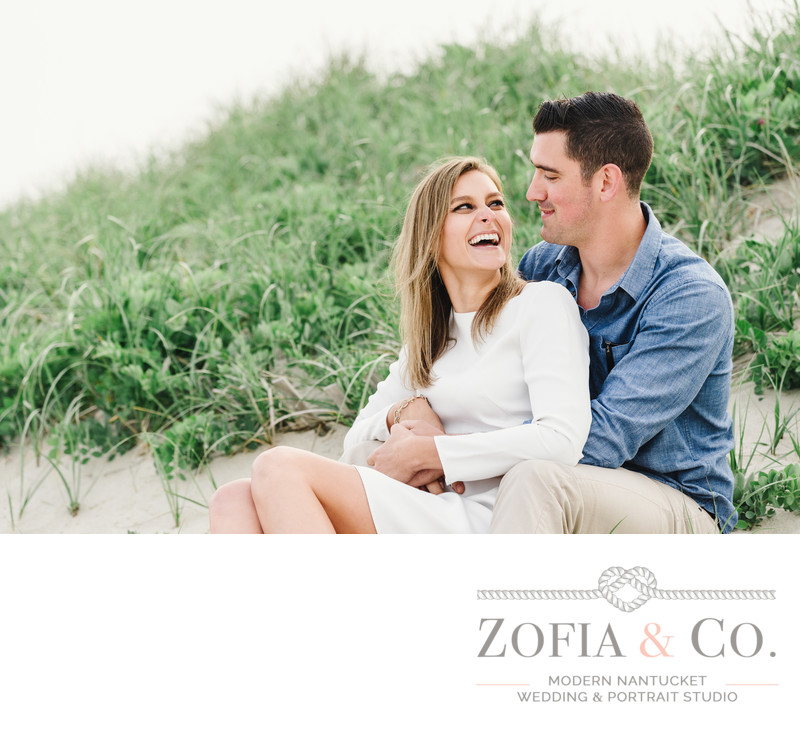 engaged couple laughing in dunes surfside beach