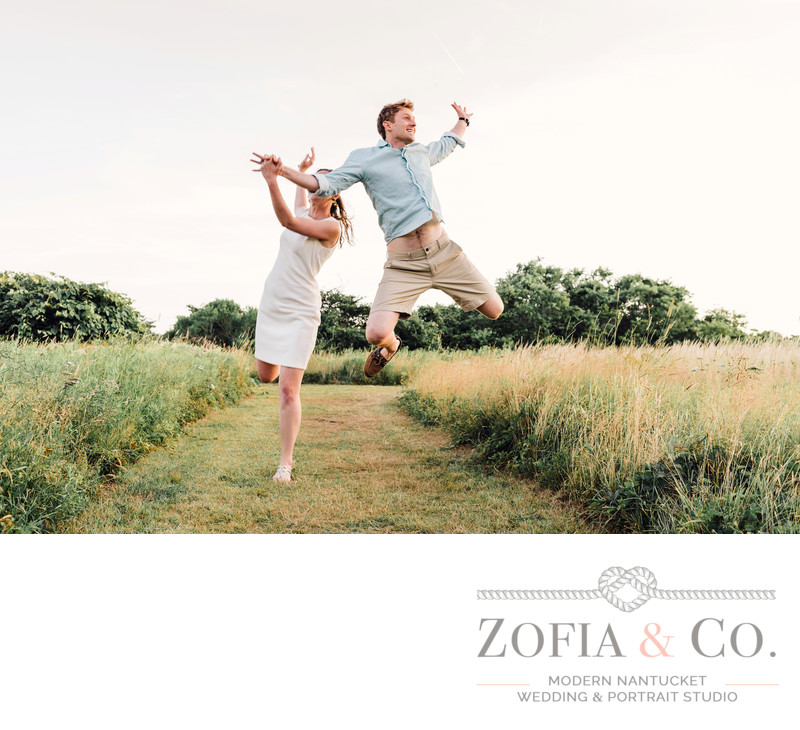 jumping for joy engaged couple madaket