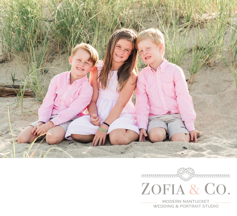 siblings in pink at sconset beach on nantucket vacation