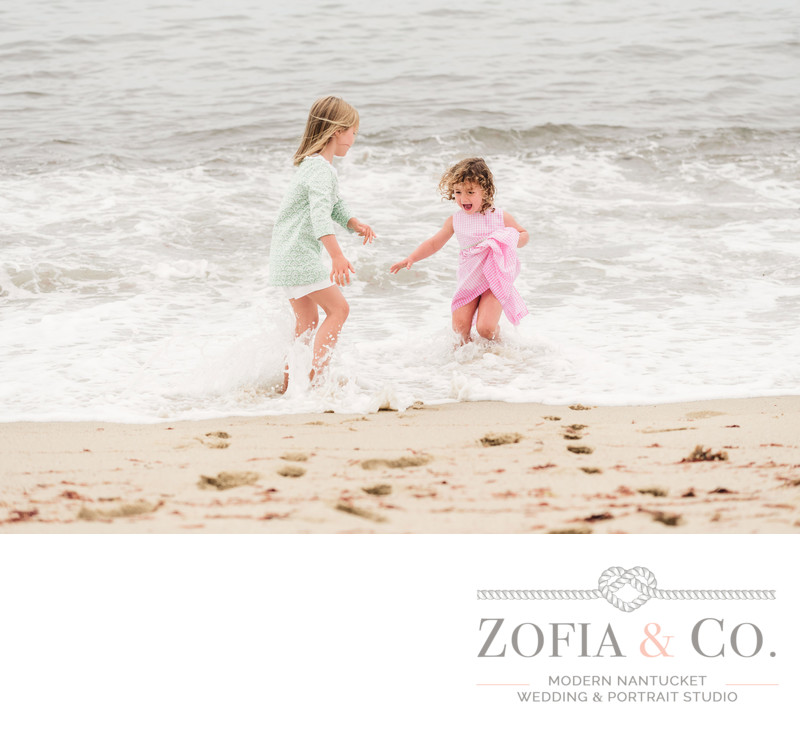 sisters playing in the ocean at sconset beach