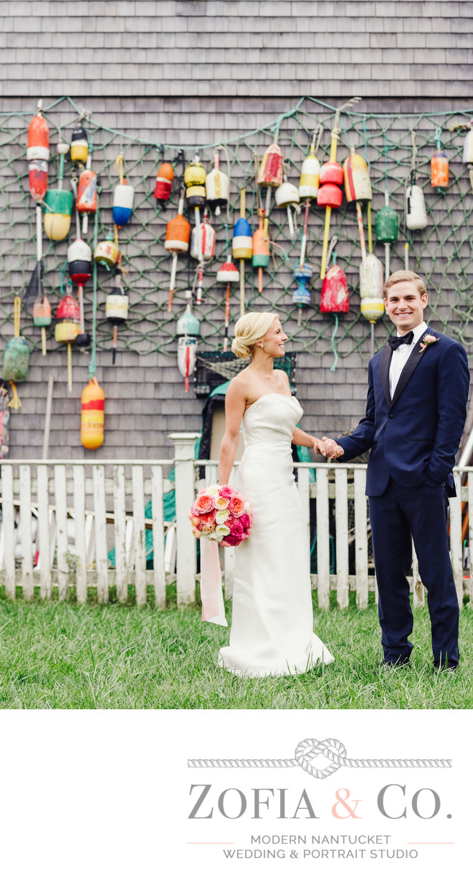 nantucket wedding couple pink bouquet bouys