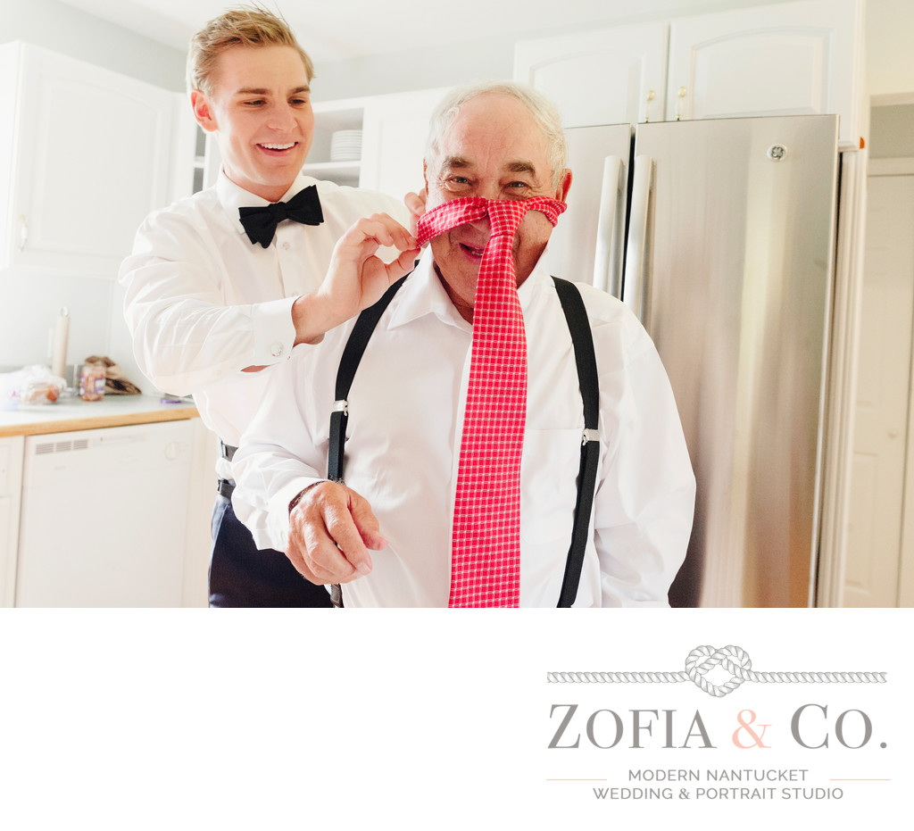 fun moment with father and groom pink tie nantucket wed