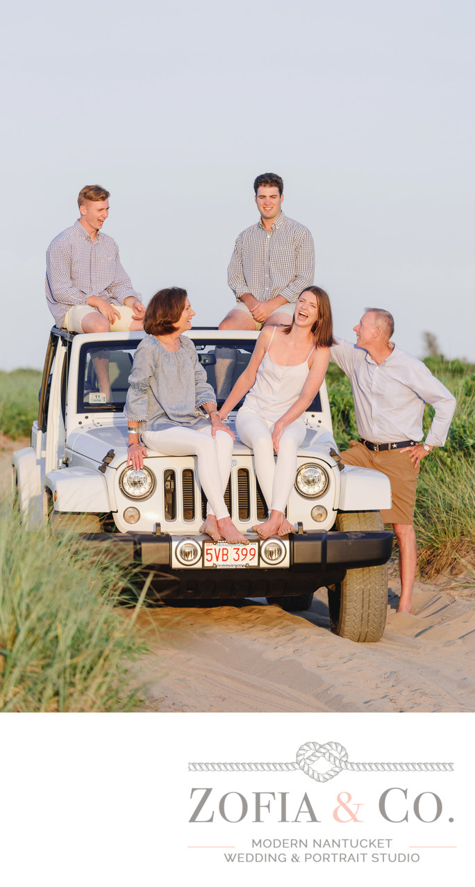 laughing casual beach family on jeep