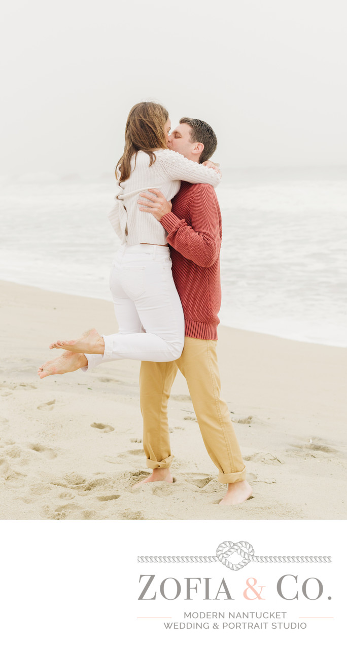 happy engaged couple on beach