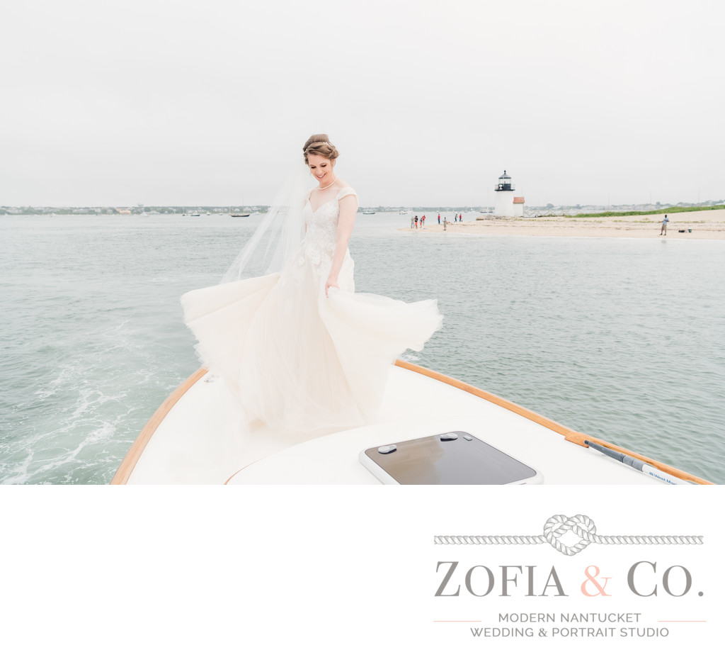 nantucket bride dancing on yacht in front of brant point