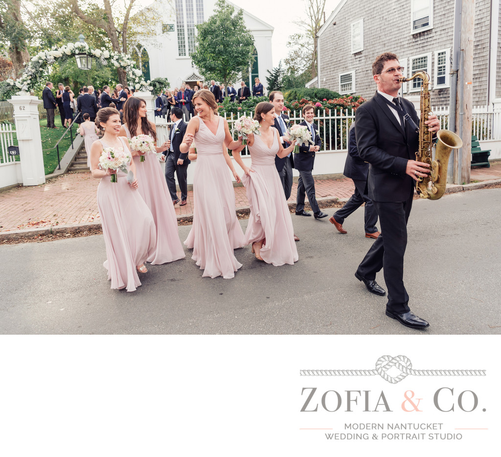 sax player leads nantucket wedding guests to yacht club