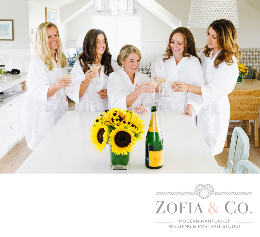Nantucket bridesmaids in monogram robes toast