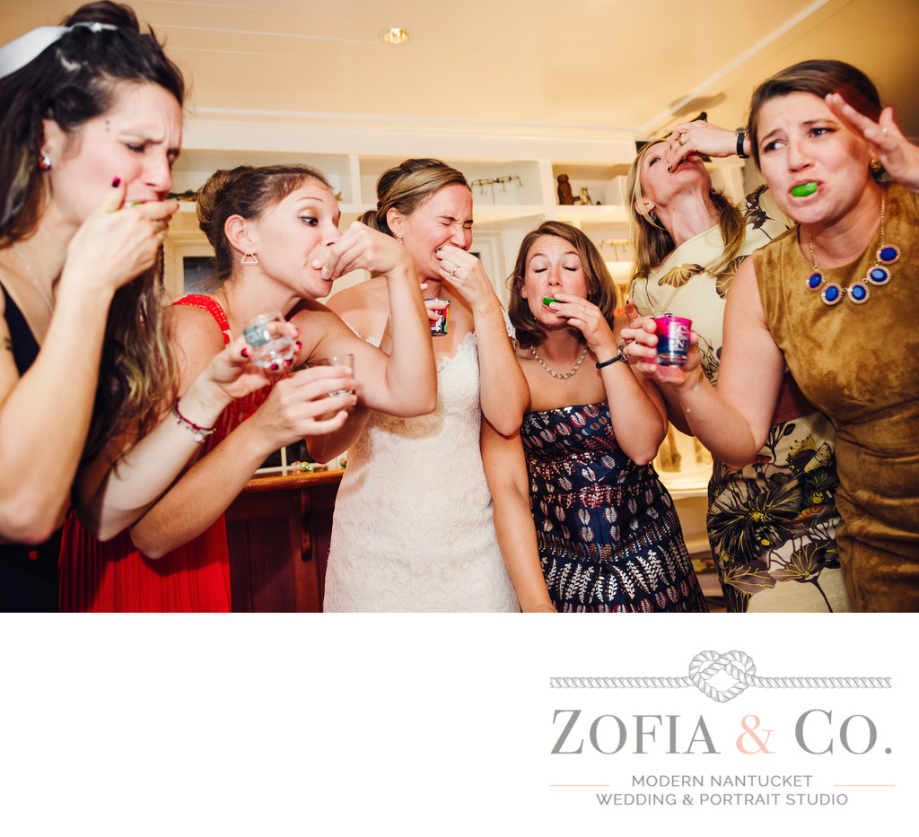 bride takes tequila shots with girlfriends