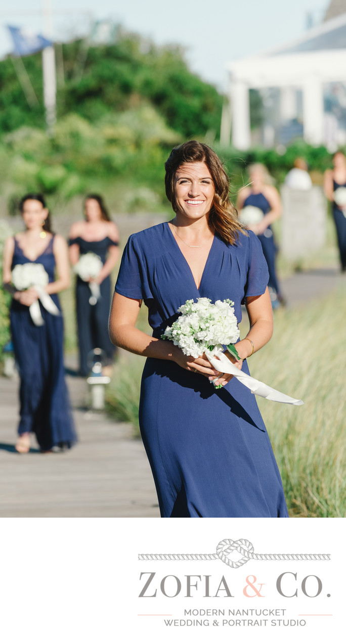 bridesmaids in navy with white flowers at wauwinet