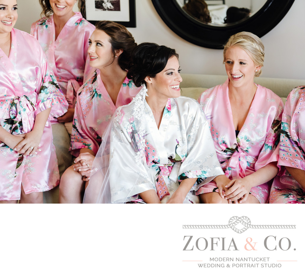 Bridesmaids in pink robes with Nantucket bride