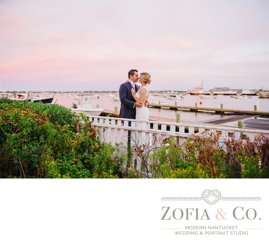 Wedding couple kiss White Elephant pink sunset