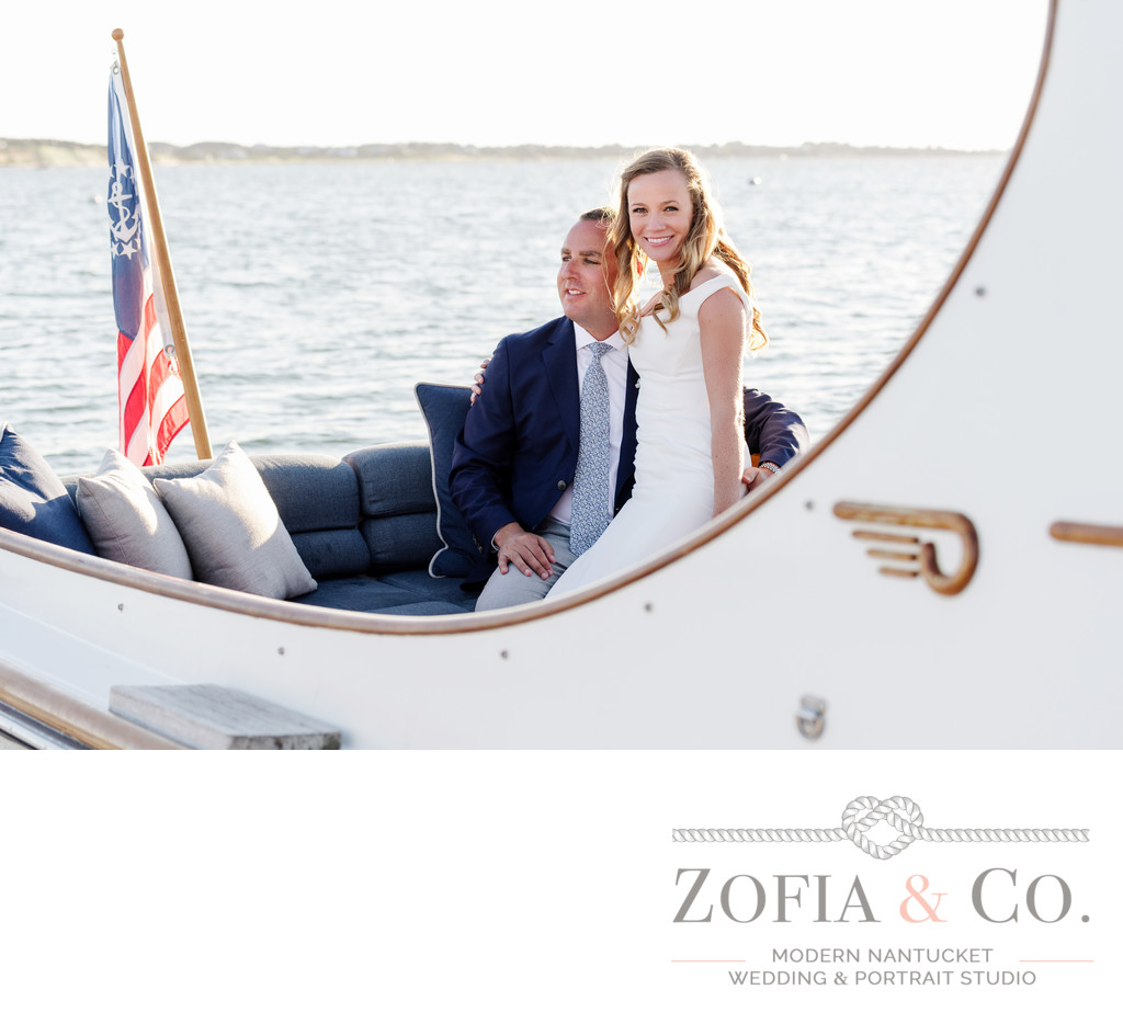 bride and groom navy on hinckley yacht wauwinet harbor