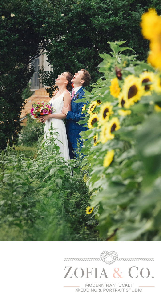 bride and groom in rain at moors end farm sunflowers