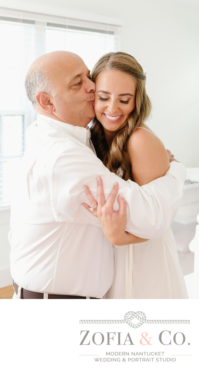 father kisses bride at home