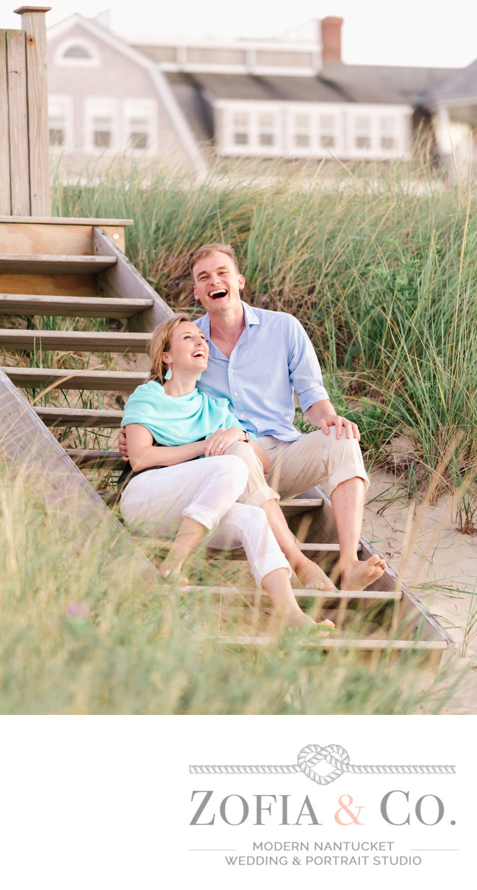 happy engaged couple candid at steps beach