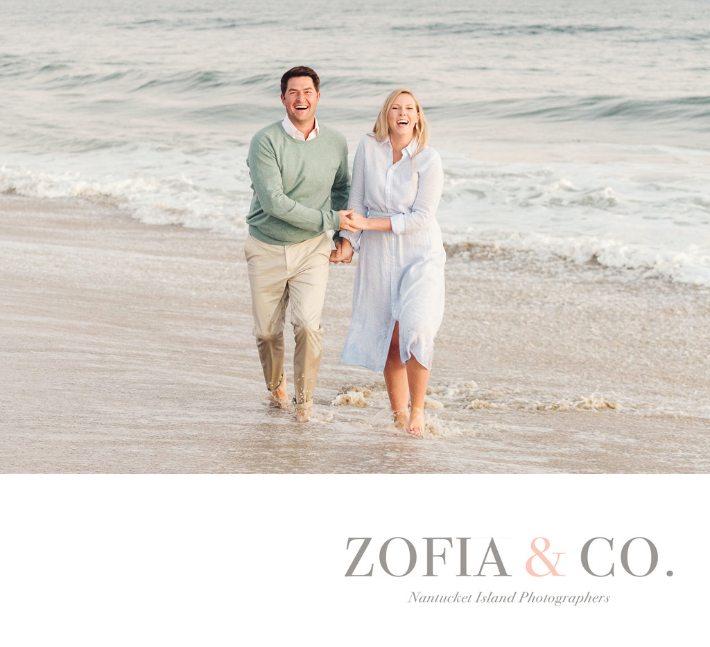 Engaged couple laughing in Nantucket ocean