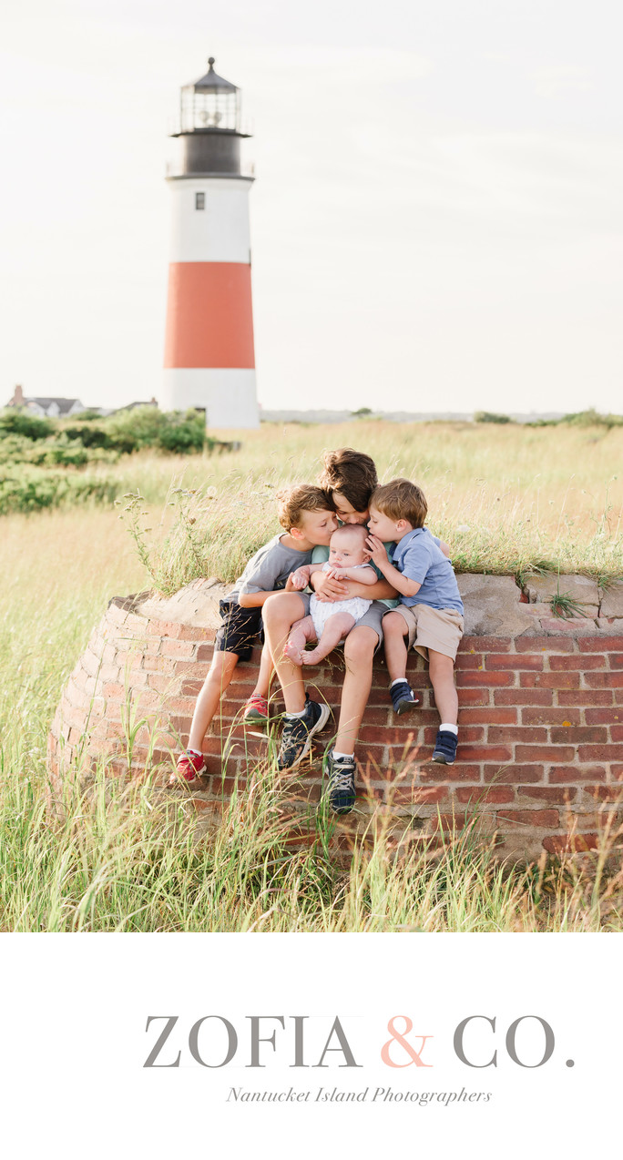 boy cousins kiss baby at Sankaty Lighthouse