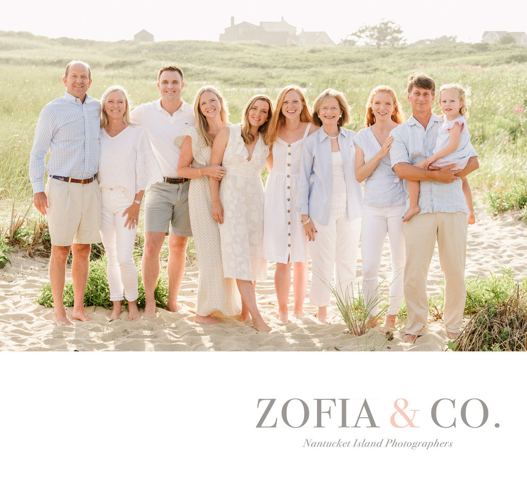 family in white and blue on Nantucket beach dunes