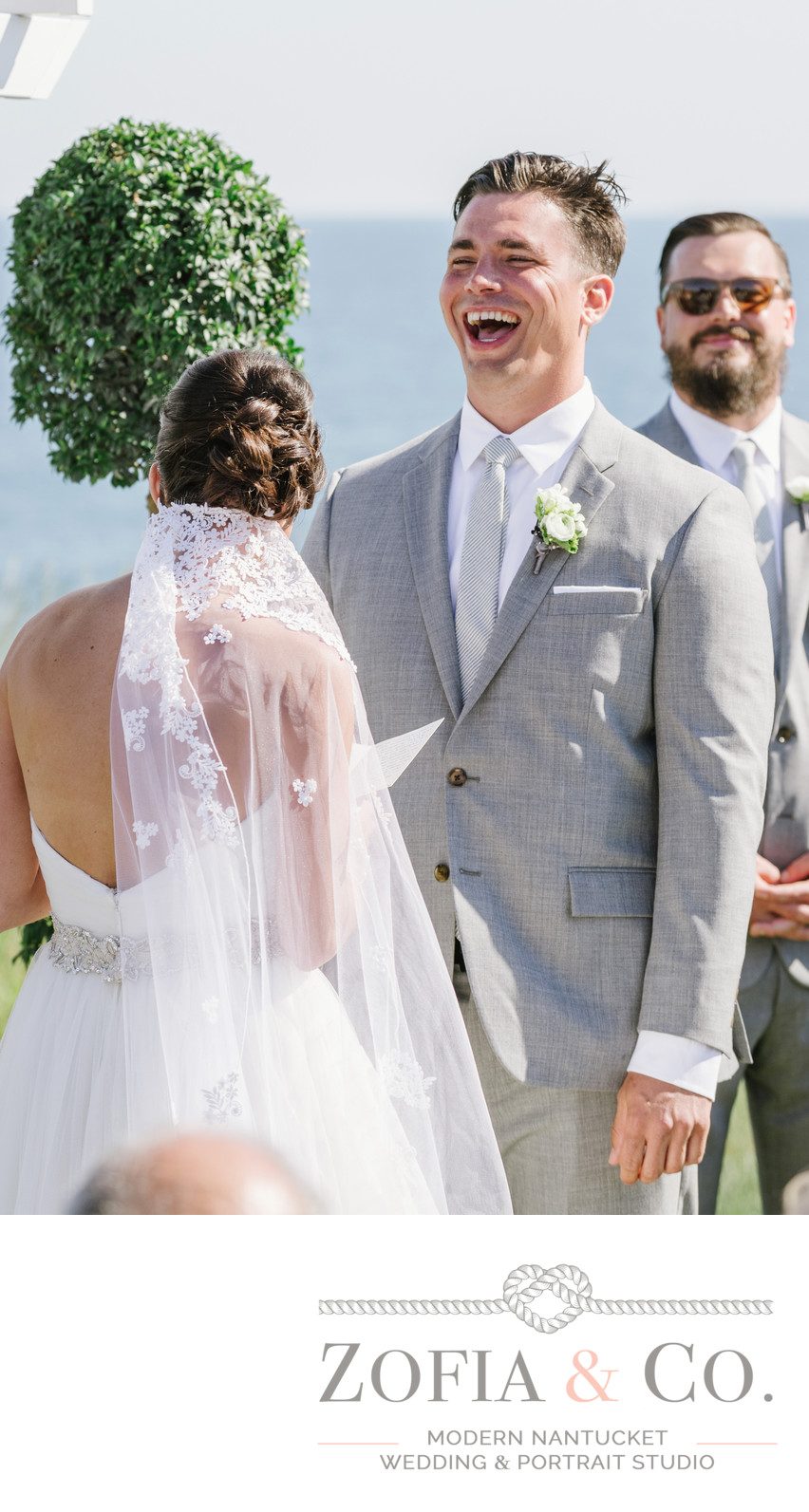 Groom laughs at Nantucket wedding ceremony at the beach