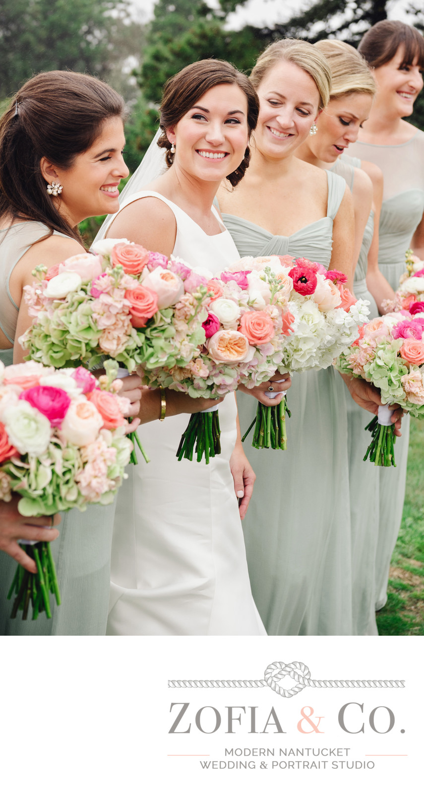 bridesmaids in green and pink flowers with nantucket bride