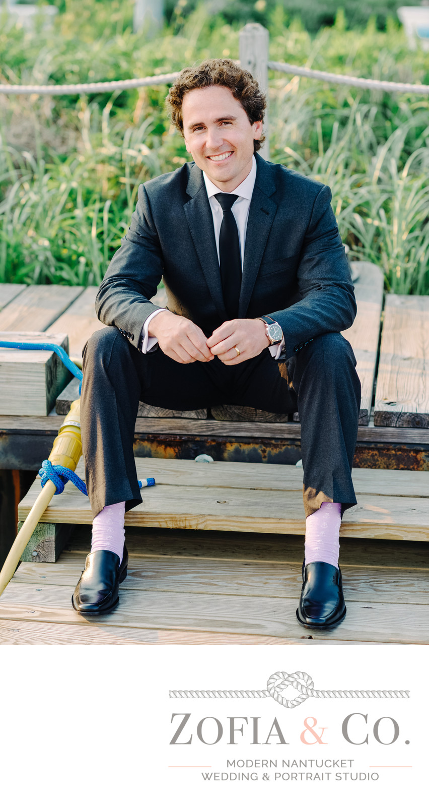 handsome White Elephant Wedding Groom with purple socks