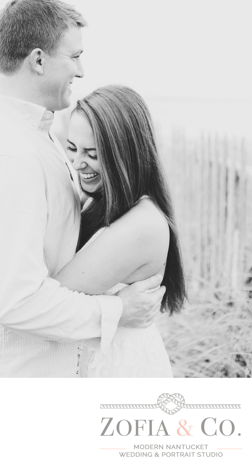 laughing engaged couple in black and white