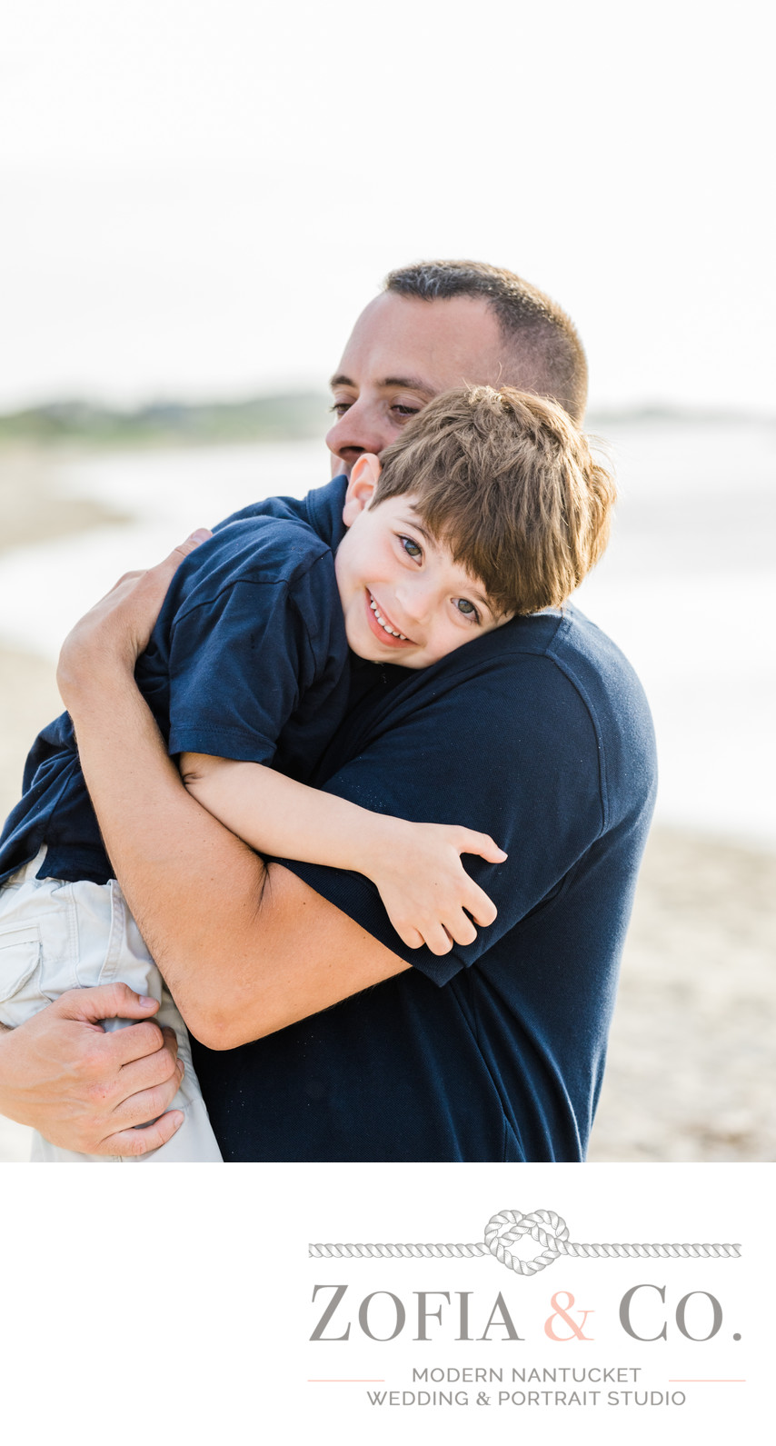 father and son hugging at Steps Beach Nantucket