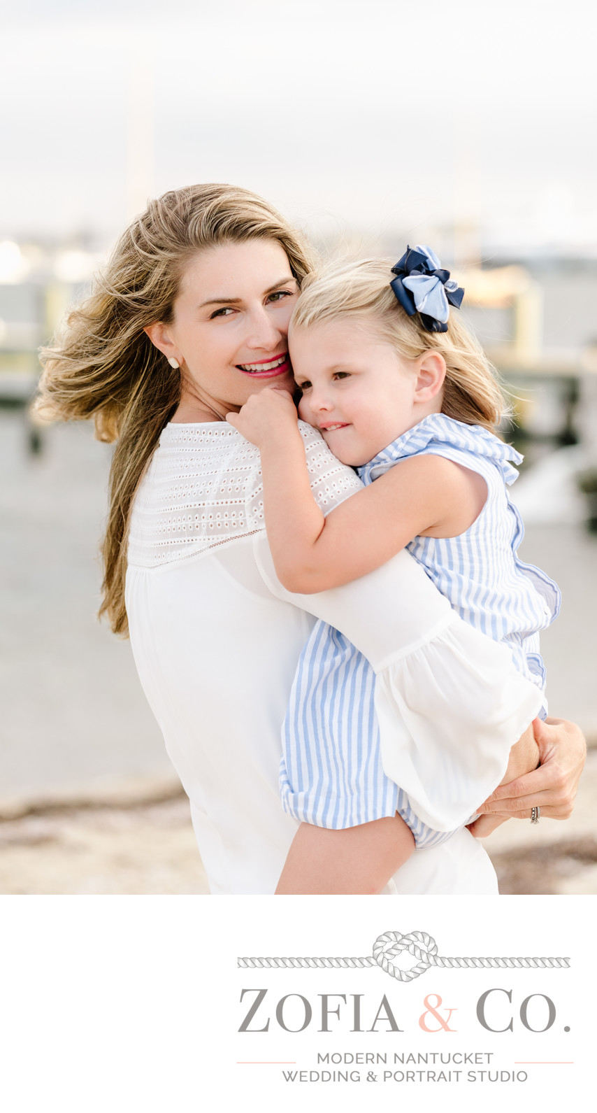 daughter hugging mother at brant point