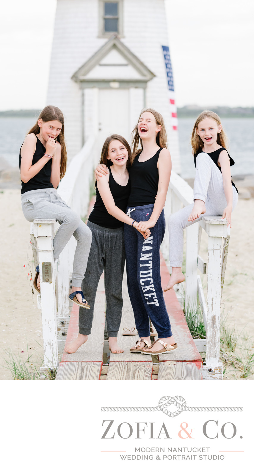 four sisters goofing around at brant point lighthouse