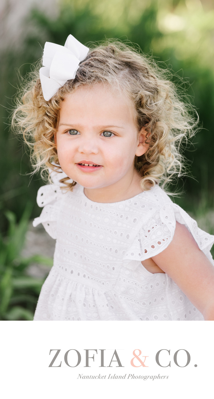 portrait of beautiful curly haired toddler girl