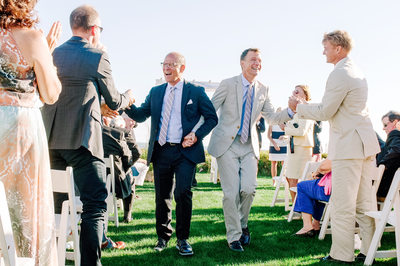 Ceremony Grooms celebrate wedding vows