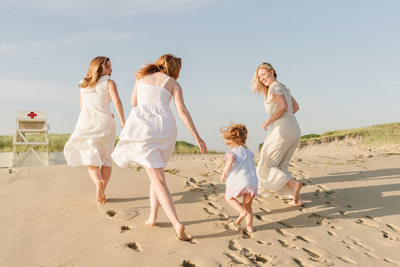 red headed sisters running on Nantucket beach