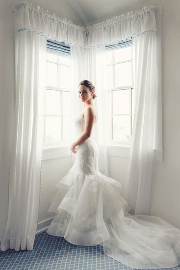 bride in monique at window before her wedding