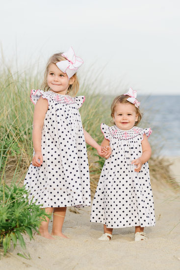 sisters in polka dots on the beach
