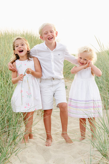 siblings laughing on nantucket dunes
