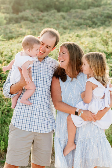 Nantucket family smiling at baby