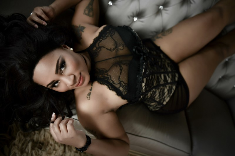 Seductive pose on couch with black woman