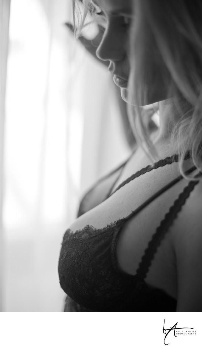 Window light boudoir posing in bra