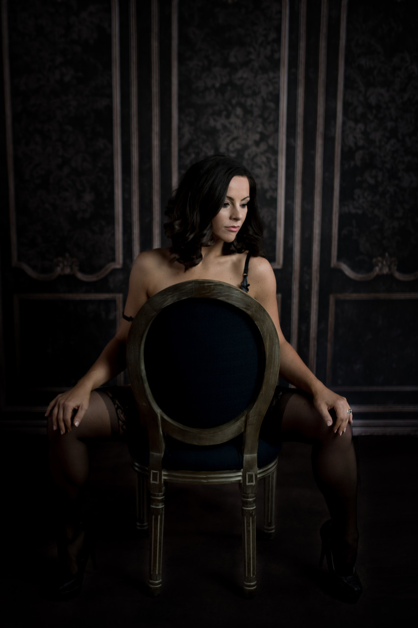 Sexy boudoir posing with a chair