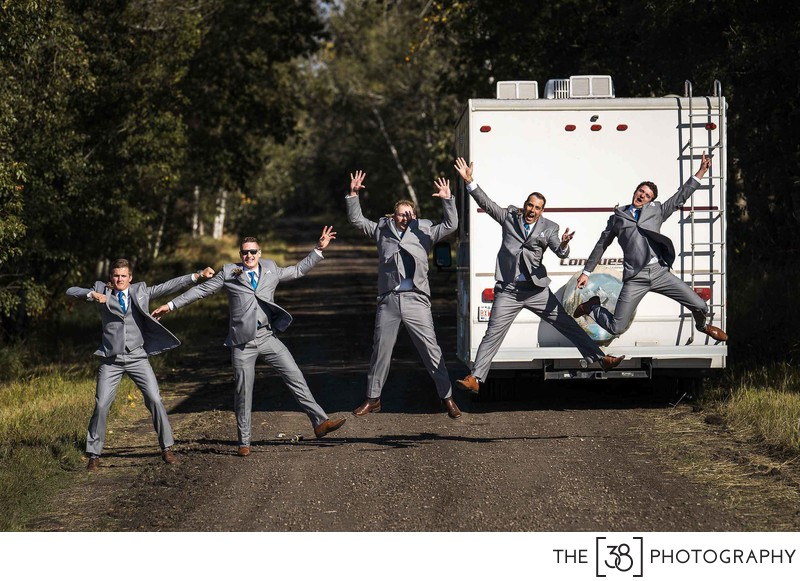 Groomsmen Jumping Photo in Alberta
