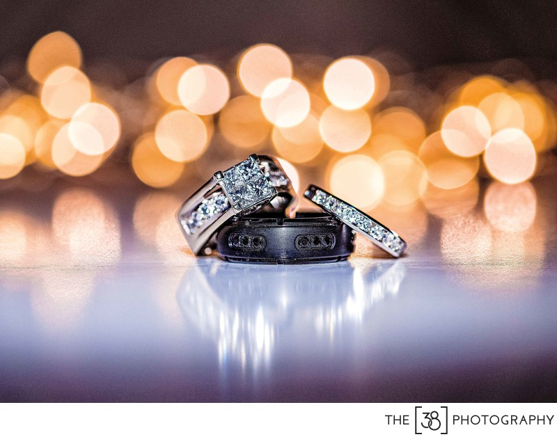 Wedding Ring Photo with Christmas Lights as Background