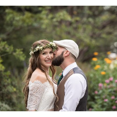Bride and Groom Kiss at Calgary Zoo Garden