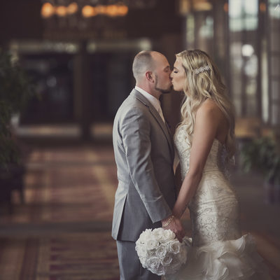 Bride and Groom Kiss in Cambridge Red Deer Hotel and Conference Centre