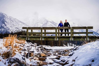 Winter Engagement Photos on the Bridge at Johnson Lake
