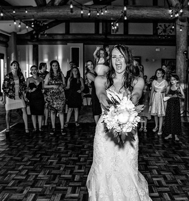 Bouquet Toss During Wedding Reception