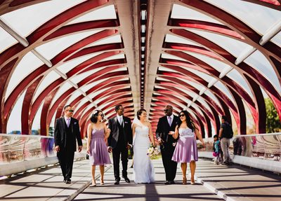 Bridal Party Walk on the Bridge