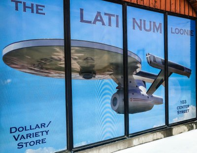 A Facade of The Latinum Loonie is a Dollar Store in Vulcan